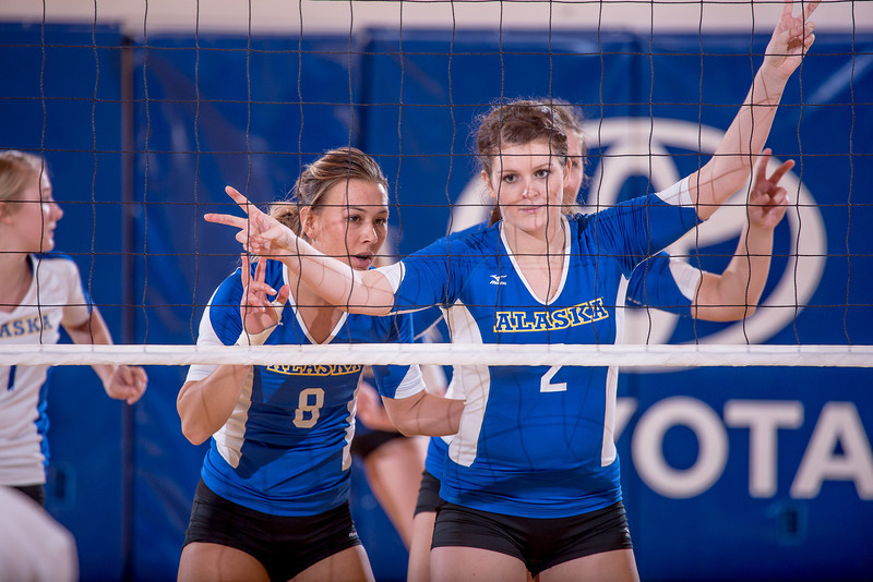 """Sophomore Morgan Tebbs, #2, and senior Reilly Stevens, #8, set a play while awaiting a serve during their match against Montana State-Billings in the Patty Center.  <div class=""""ss-paypal-button"""">Filename: ATH-12-3638-135.jpg</div><div class=""""ss-paypal-button-end"""" style=""""""""></div>"""