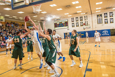 Senior Mike Stepovich scores inside late in the Nanooks' game against the UAA Seawolves in the Patty Gym. The crucial bucket helped the Nanooks overcome a 13-point second-half deficit and defeat the Seawolves on a buzzer-beating bucket by Andrew Kelly.  Filename: ATH-14-4097-12.jpg