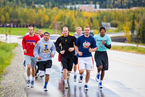 """Members of the Nanook basketball team get in a workout running up Tanana Loop on a recent rainy afternoon.  <div class=""""ss-paypal-button"""">Filename: ATH-12-3535-13.jpg</div><div class=""""ss-paypal-button-end"""" style=""""""""></div>"""