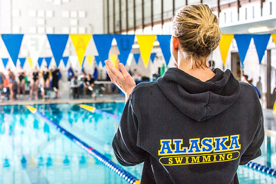 Senior Bente Heller cheers on her teammates during the Nanooks' meet against Loyola Marymount in the Patty Pool.  Filename: ATH-13-3991-224.jpg