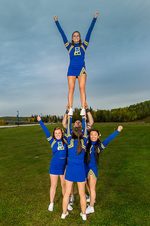 UAF cheerleaders strike a pose in front of the SRC on the Fairbanks campus.  Filename: ATH-13-3943-50.jpg
