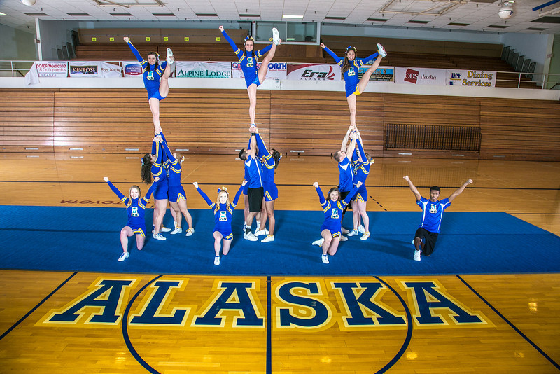 """The UAF cheerleading squad performs a variety of poses and routines during a practice session in the Patty Gym.  <div class=""""ss-paypal-button"""">Filename: ATH-13-3751-40.jpg</div><div class=""""ss-paypal-button-end"""" style=""""""""></div>"""