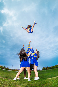 UAF cheerleaders practice in front of the SRC on the Fairbanks campus.  Filename: ATH-13-3943-112.jpg