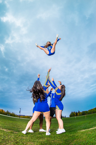 """UAF cheerleaders practice in front of the SRC on the Fairbanks campus.  <div class=""""ss-paypal-button"""">Filename: ATH-13-3943-112.jpg</div><div class=""""ss-paypal-button-end"""" style=""""""""></div>"""