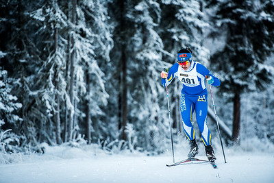 Junior Seiji Takagi sprints up a hill near the middle of the Nanooks' 8.5km race on Saturday. The Nanooks won the two day Nordic cup over UAA and APU by a margin of 4 minutes and 8 seconds.  Filename: ATH-16-5069-53.jpg