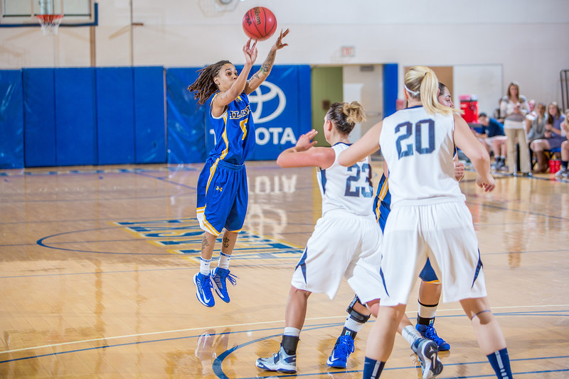 """Junior Destini Lewis shoot a three-pointer during second half action in the Nanooks' game against the Colorado School of Mines in the Patty Center.  <div class=""""ss-paypal-button"""">Filename: ATH-12-3639-103.jpg</div><div class=""""ss-paypal-button-end"""" style=""""""""></div>"""