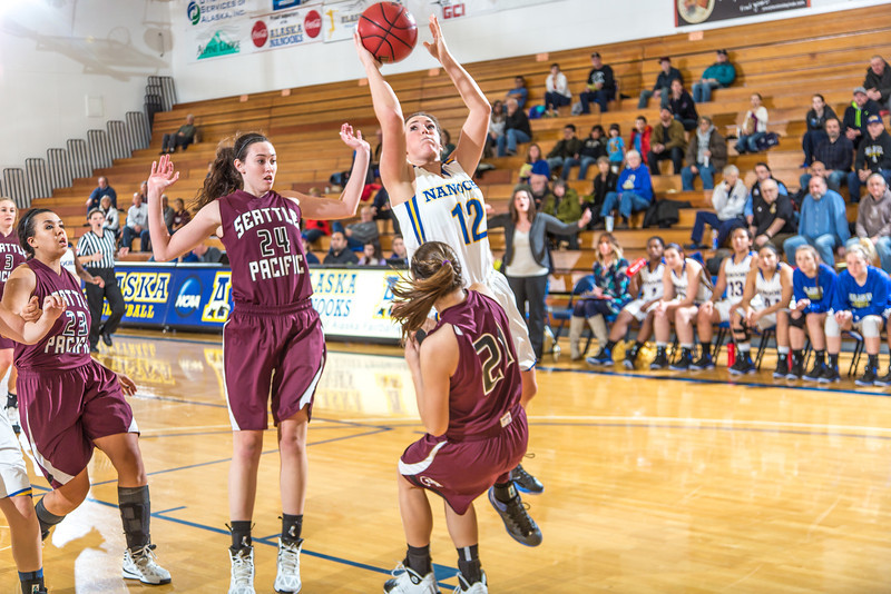 """Junior guard Kelly Logue scored and drew a blocking foul on this play during the second half of the Nanooks' first GNAC game of the season against Seattle Pacific.  <div class=""""ss-paypal-button"""">Filename: ATH-13-4015-82.jpg</div><div class=""""ss-paypal-button-end"""" style=""""""""></div>"""