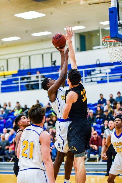 """Zach Pederson watches as a teammate reaches over a player from Cal State LA during the Nanooks' game on Nov. 21 in the Patty Gym.  <div class=""""ss-paypal-button"""">Filename: ATH-16-5072-33.jpg</div><div class=""""ss-paypal-button-end""""></div>"""