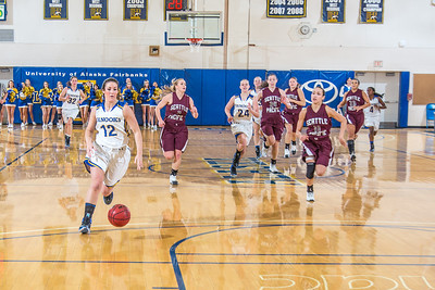 Junior guard Kelly Logue leads a fast break during the Nanooks' first GNAC game of the season against Seattle Pacific.  Filename: ATH-13-4015-83.jpg