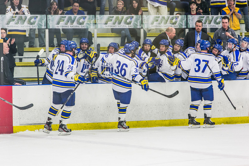 """Nanooks Cody Kunyk, 37, Colton Beck, 36, and Nolan Huysmans are congratulated after Kunyk scored the winning goal late in the final period of their game against Mercyhurst in the Patty Ice Arena.  <div class=""""ss-paypal-button"""">Filename: ATH-13-3982-202.jpg</div><div class=""""ss-paypal-button-end"""" style=""""""""></div>"""