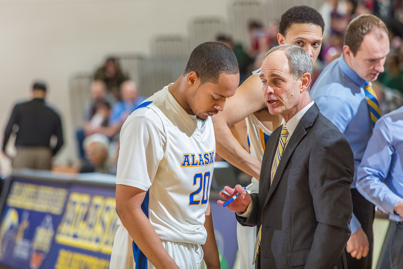 """Head coach Mick Durham gets his point across to point guard Joe Slocum during a timeout in the Nanooks' game against Northwest Nazarene in the Patty Gym.  <div class=""""ss-paypal-button"""">Filename: ATH-14-4041-173.jpg</div><div class=""""ss-paypal-button-end"""" style=""""""""></div>"""