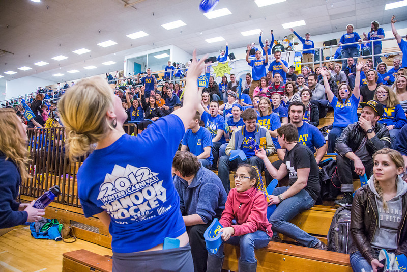 """UAF Traditions students Teal Rogers and Katie Griffin, far left, toss free water bottles into the crowd before the Nanooks hosted the rival UAA Seawolves in the Patty Center.  <div class=""""ss-paypal-button"""">Filename: ATH-13-3700-6.jpg</div><div class=""""ss-paypal-button-end"""" style=""""""""></div>"""