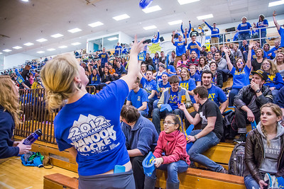UAF Traditions students Teal Rogers and Katie Griffin, far left, toss free water bottles into the crowd before the Nanooks hosted the rival UAA Seawolves in the Patty Center.  Filename: ATH-13-3700-6.jpg