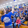 "UAF Traditions students Teal Rogers and Katie Griffin, far left, toss free water bottles into the crowd before the Nanooks hosted the rival UAA Seawolves in the Patty Center.  <div class=""ss-paypal-button"">Filename: ATH-13-3700-6.jpg</div><div class=""ss-paypal-button-end"" style=""""></div>"