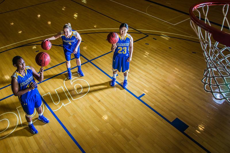 "Seniors Teanna Boxley, left, and Taylor Altenburg, center, join junior Marissa Atoruk on the Patty Center court.  <div class=""ss-paypal-button"">Filename: ATH-12-3625-014.jpg</div><div class=""ss-paypal-button-end"" style=""""></div>"