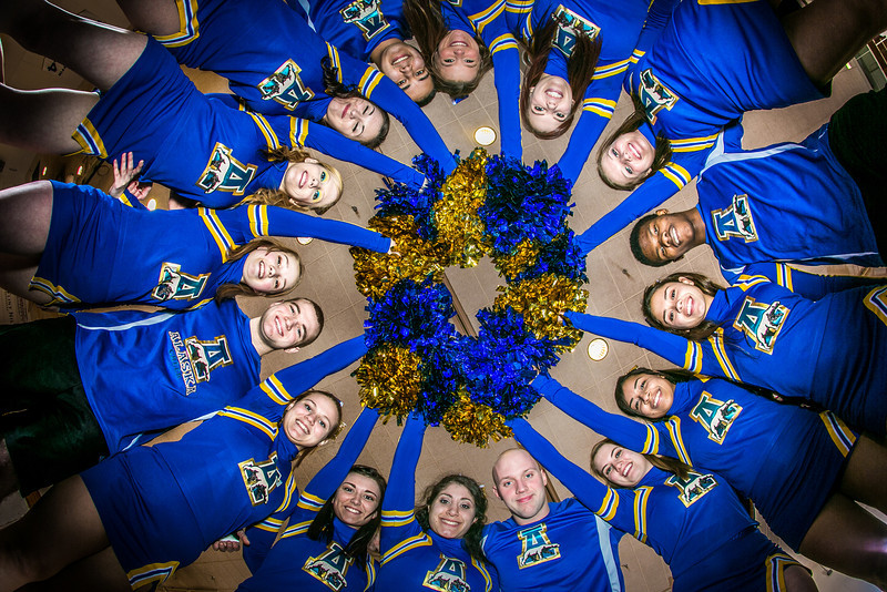 """The UAF cheerleading squad performs a variety of poses and routines during a practice session in the Patty Gym.  <div class=""""ss-paypal-button"""">Filename: ATH-13-3751-317.jpg</div><div class=""""ss-paypal-button-end"""" style=""""""""></div>"""