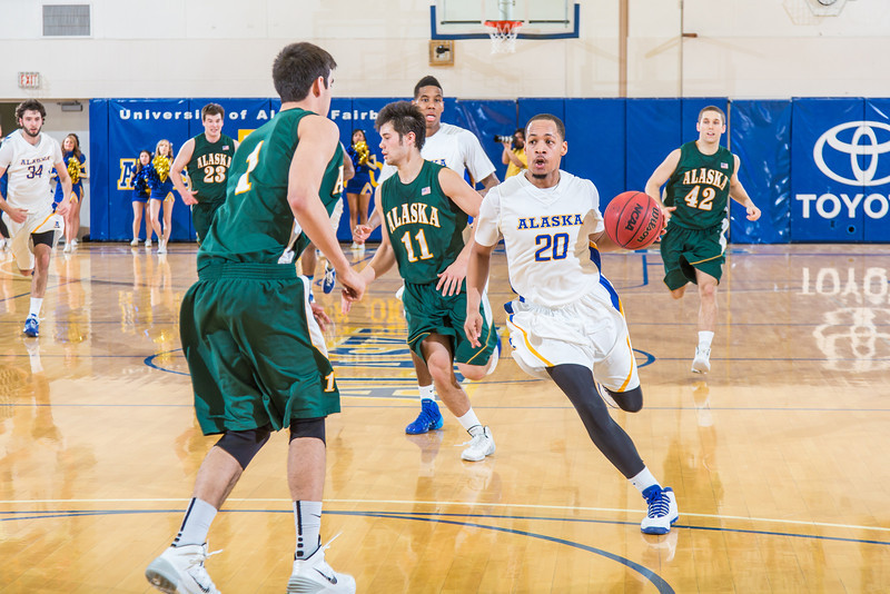 "Junior point guard Joe Slocum leads a fast break llate in the Nanooks' game against the UAA Seawolves in the Patty Gym. Slocum helped lead the Nanooks from a 13-point second-half deficit and later scored at the buzzer to provide the final margin in their two-point victory.  <div class=""ss-paypal-button"">Filename: ATH-14-4097-26.jpg</div><div class=""ss-paypal-button-end"" style=""""></div>"