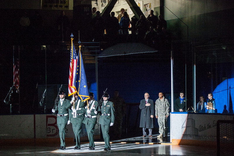 """Army ROTC cadets bring out the colors for the National Anthem before a hockey game.  <div class=""""ss-paypal-button"""">Filename: ATH-12-3656-10.jpg</div><div class=""""ss-paypal-button-end"""" style=""""""""></div>"""