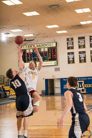 Senior Alex Duncan puts up an off-balance shot from close distance during the Nanooks' 92-69 win over Concordia University Feb. 20 in the Patty Gym.  Filename: ATH-16-4810-60.jpg