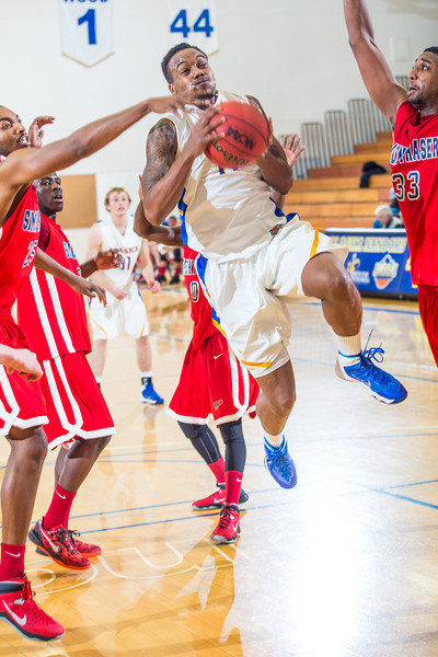 "Guard Ronnie Baker finds it tough going inside against taller Simon Fraser defenders during another Nanook win in the Patty Gym.  <div class=""ss-paypal-button"">Filename: ATH-14-4029-116.jpg</div><div class=""ss-paypal-button-end"" style=""""></div>"