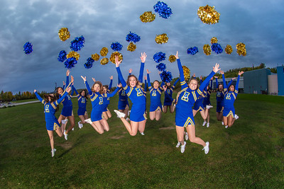 UAF cheerleaders pose in front of the SRC on the Fairbanks campus.  Filename: ATH-13-3943-135.jpg