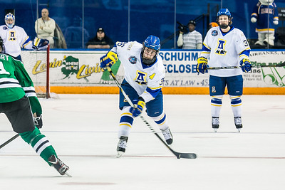 Junior Colton Beck winds up for a slap shot during the Nanooks' 2-1 win over North Dakota in the Carlson Center.  Filename: ATH-12-3601-91.jpg