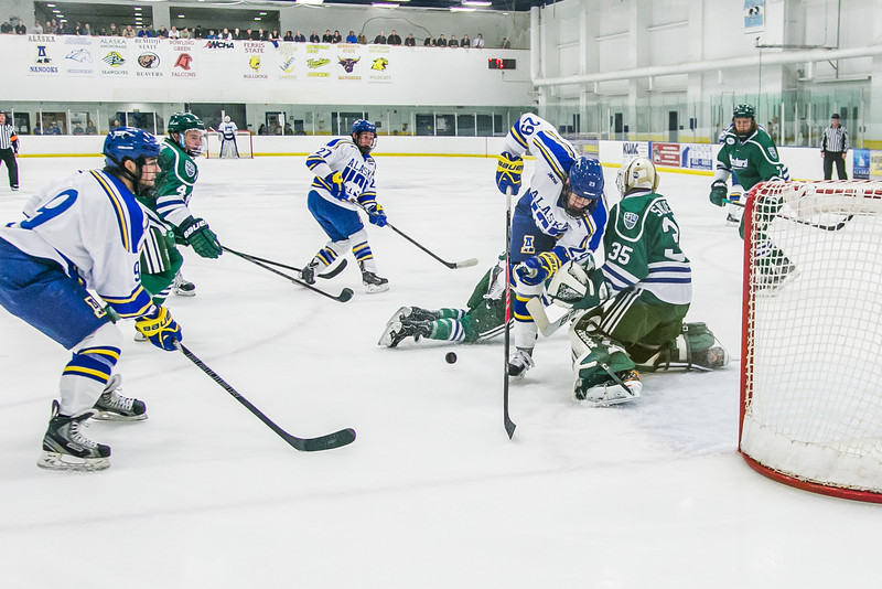 """Jarod Larson gets tripped up on his way to the goal early in the Nanooks' game against Mercyhurst in the Patty Ice Arena.  <div class=""""ss-paypal-button"""">Filename: ATH-13-3982-24.jpg</div><div class=""""ss-paypal-button-end"""" style=""""""""></div>"""