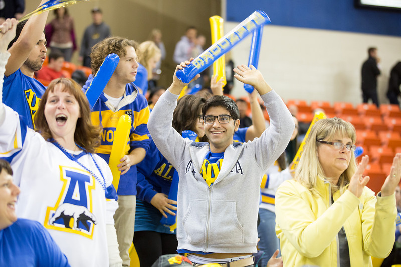 "Jonatan Lucas de Moraes cheers with the UAF supporters after the Mens Hockey Team makes a goal on the first game of the Alaska Airlines Governor's Cup at the Sullivan Arena in Anchorage.  <div class=""ss-paypal-button"">Filename: ATH-13-4017-165.jpg</div><div class=""ss-paypal-button-end"" style=""""></div>"