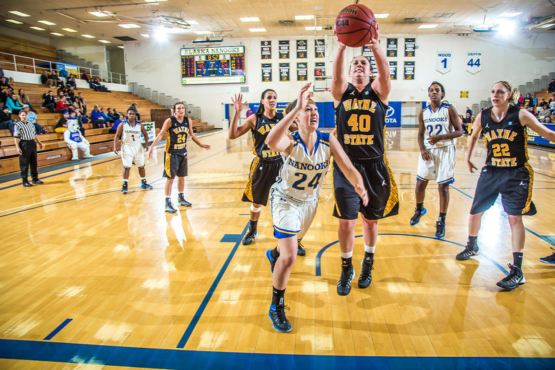 """Freshman guard Autumn Bhilders tries for an offensive rebound during the second half of the championship game of the North Star Invitational Tournament against Wayne State in the Patty Gym.  <div class=""""ss-paypal-button"""">Filename: ATH-13-4010-109.jpg</div><div class=""""ss-paypal-button-end"""" style=""""""""></div>"""