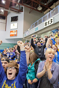 Fans in the student section of the Carlson Center react to a goal by the Nanooks during their battle against the UAA Seawolves for the coveted Governor's Cup trophy.  Filename: ATH-12-3304-122.jpg