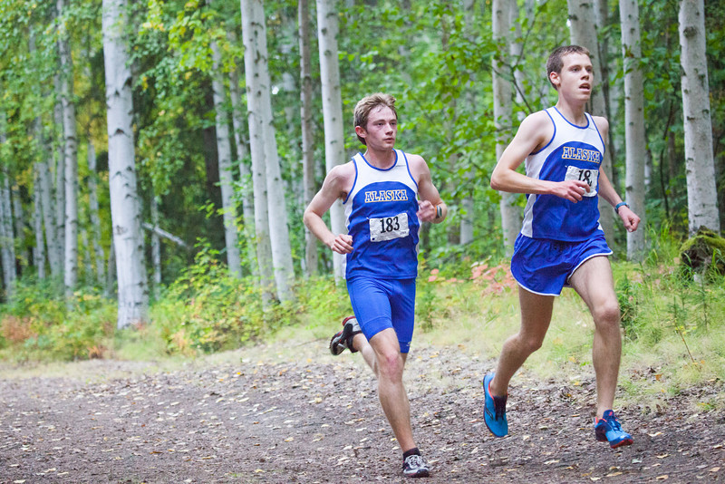 """Tux Seims and Ross MacDougal races to the finish line Thursday, August 30, 2012 on the UAF West Ridge ski trails.  <div class=""""ss-paypal-button"""">Filename: ATH-12-3530-61.jpg</div><div class=""""ss-paypal-button-end"""" style=""""""""></div>"""