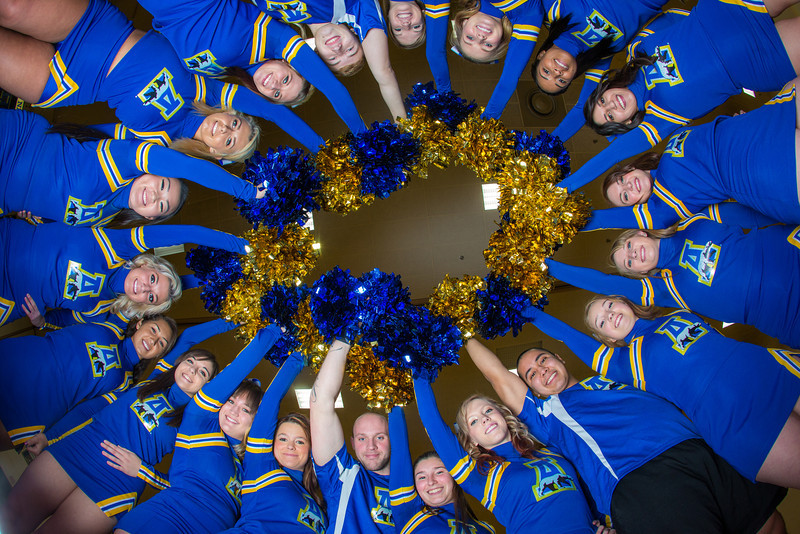 """The 2014 Nanook cheerleaders pose in the Patty Gym.  <div class=""""ss-paypal-button"""">Filename: ATH-14-4044-28.jpg</div><div class=""""ss-paypal-button-end"""" style=""""""""></div>"""