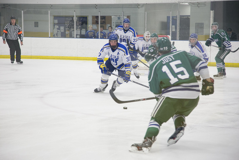 """Senior Cody Kunyk, 37, races for the puck in front the the net during the Nanooks' game against the Mercyhurst Lakers in the Patty Ice Arena.  <div class=""""ss-paypal-button"""">Filename: ATH-13-3982-130.jpg</div><div class=""""ss-paypal-button-end"""" style=""""""""></div>"""