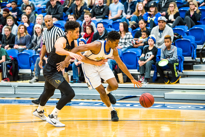 """Ladonavan Wilder dribbles around a member of the Cal State LA team during the Nanooks' game on Nov. 21 in the Patty Gym.  <div class=""""ss-paypal-button"""">Filename: ATH-16-5072-57.jpg</div><div class=""""ss-paypal-button-end""""></div>"""