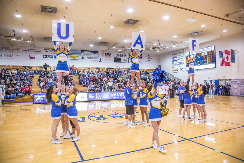 """UAF cheerleaders keep the crowd entertained during a timeout in the Nanooks' game against the UAA Seawolves in the Patty Center.  <div class=""""ss-paypal-button"""">Filename: ATH-13-3700-66.jpg</div><div class=""""ss-paypal-button-end"""" style=""""""""></div>"""