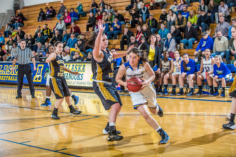 """Freshman forward Kaillee Skjold drives toward the hoop during the second half of the championship game of the North Star Invitational Tournament against Wayne State in the Patty Gym.  <div class=""""ss-paypal-button"""">Filename: ATH-13-4010-90.jpg</div><div class=""""ss-paypal-button-end"""" style=""""""""></div>"""
