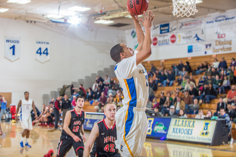 """Junior guard Joe Slocum scores on a fast break during the Nanooks' game against Northwest Nazarene in the Patty Gym.  <div class=""""ss-paypal-button"""">Filename: ATH-14-4041-189.jpg</div><div class=""""ss-paypal-button-end"""" style=""""""""></div>"""