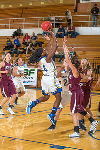 Junior point guard Benissa Bulaya puts up a running one-handed shot during the Nanooks' first GNAC game of the season against Seattle Pacific.  Filename: ATH-13-4015-12.jpg