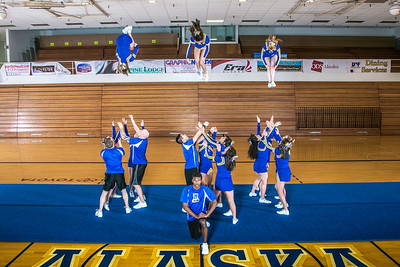 The UAF cheerleading squad performs a variety of poses and routines during a practice session in the Patty Gym.  Filename: ATH-13-3751-63.jpg