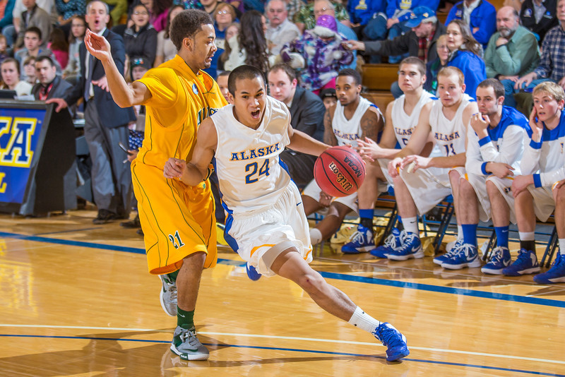 """Junior point guard Pat Voeut drives around his defender during the Nanooks game against the UAA Seawolves in the Patty Center.  <div class=""""ss-paypal-button"""">Filename: ATH-13-3700-182.jpg</div><div class=""""ss-paypal-button-end"""" style=""""""""></div>"""