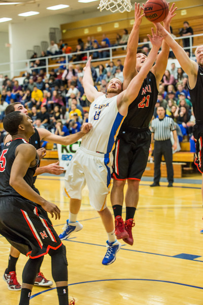 """Senior Dallen Bills battles for an offensive rebound during the Nanooks' game against Northwest Nazarene in the Patty Gym.  <div class=""""ss-paypal-button"""">Filename: ATH-14-4041-124.jpg</div><div class=""""ss-paypal-button-end"""" style=""""""""></div>"""