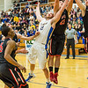 "Senior Dallen Bills battles for an offensive rebound during the Nanooks' game against Northwest Nazarene in the Patty Gym.  <div class=""ss-paypal-button"">Filename: ATH-14-4041-124.jpg</div><div class=""ss-paypal-button-end"" style=""""></div>"