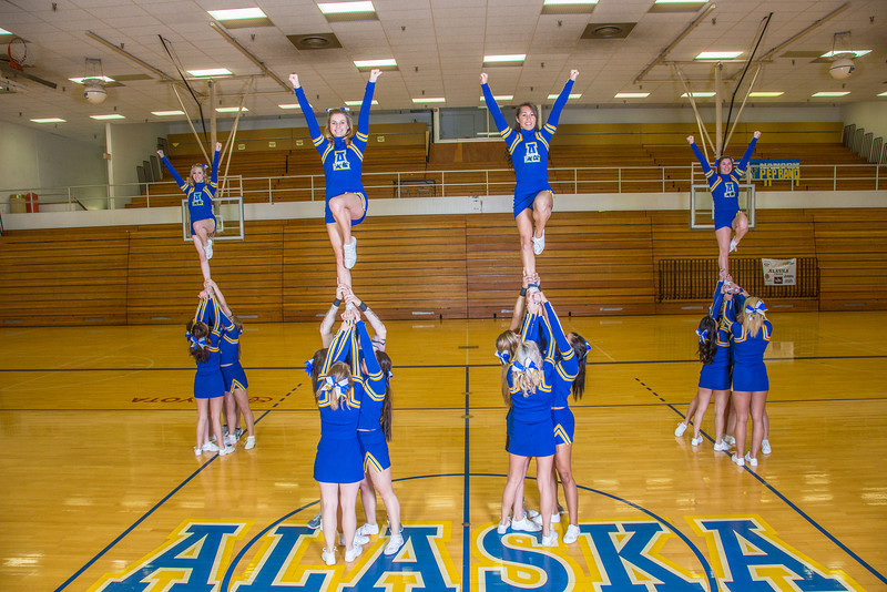 """The 2014 Nanook cheerleaders pose in the Patty Gym.  <div class=""""ss-paypal-button"""">Filename: ATH-14-4044-44.jpg</div><div class=""""ss-paypal-button-end"""" style=""""""""></div>"""
