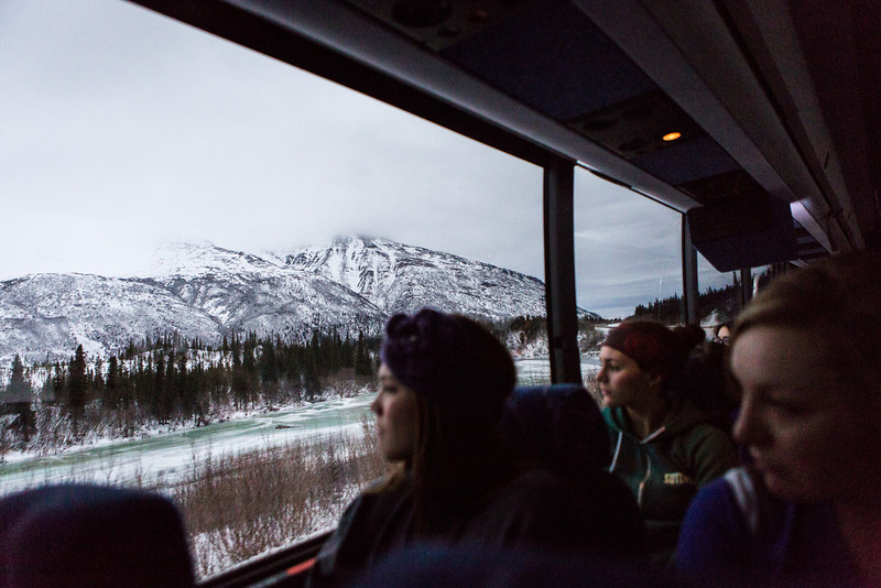 "A chartered bus carrying a UAF contingent drives on the scenic Parks Highway en route to Anchorage to support the men's' hockey team for the Governor's Cup match.  <div class=""ss-paypal-button"">Filename: ATH-13-4017-65.jpg</div><div class=""ss-paypal-button-end"" style=""""></div>"