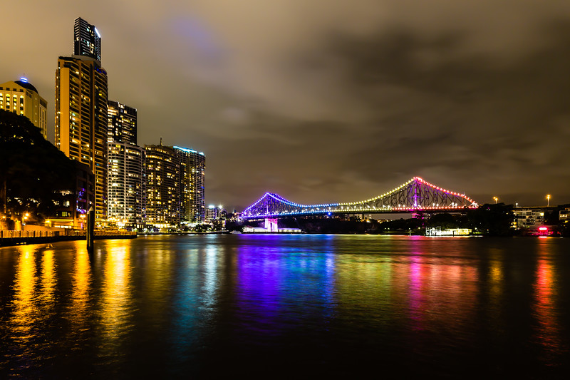 A nice evening today in Brisbane. Cloudy, cool, and slightly windy but no rain. On previous visits to Brisbane, the Story Bridge has always been lighted in purple. But today, its lighting has been cycling between various rainbow colors. Very nice!