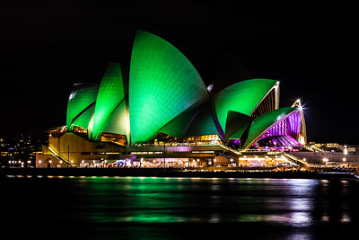 The Sydney Opera House lit up green after Earth Hour.