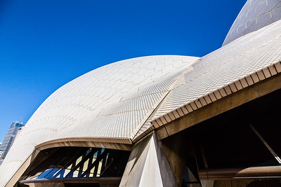 A close up of the side of the Sydney Opera House, showing some of the thousands of little off-white tiles that make up its outer surface. The tour guide mentioned that they don't have to wash the tiles - rain keeps them clean. He also said that they're not white so that the structure doesn't become blinding in the sun, which makes sense.