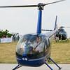 Robinson R44 taking off