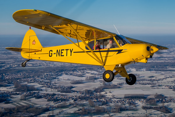 PA-18 Piper Super Cub over a snowy Flanders (Belgium)