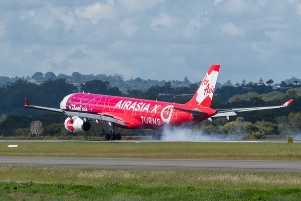 MMPI_20200216_MMPI0063_0036 - AirAsia X Airbus A330-343 9M-XXA as flight D7200 touches down at Gold Coast Airport (YBCG) ex Kuala Lumpur (WMKK).